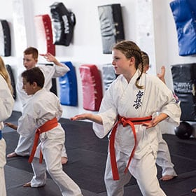 rma total fitness junior members in orange belts having a training