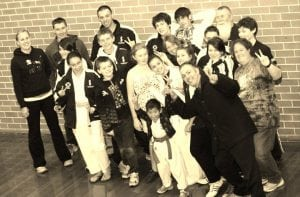 taekwondo participants together with their family and friends
