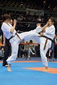 two girls having a taekwondo fight
