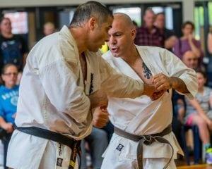 two matured man having an taekwondo fight