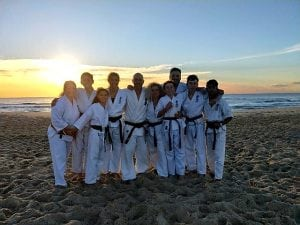 rma total fitness member are in the beach under the sunset