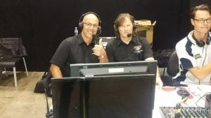 two mans in black uniform is an event announcer